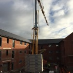 Potain IGO50 Self Erecting Tower Crane on an Apartment Complex